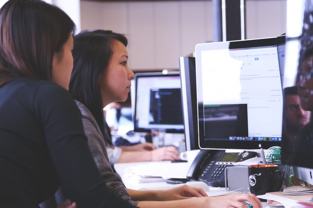 Two women doing bookkeeping at a computer